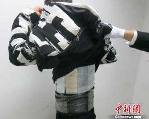 深圳查获绑藏手机 4人身上竟绑藏了近200部iPhone手机入境